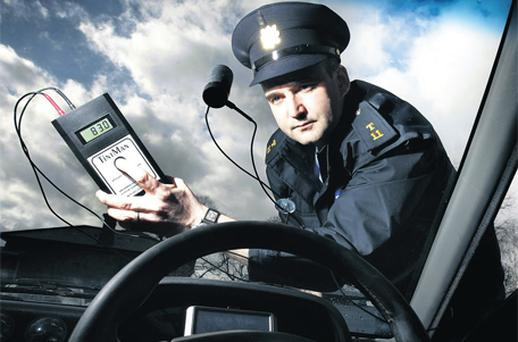Sgt William Geraghty, from the traffic division at Dublin Castle, using the TintMan device yesterday