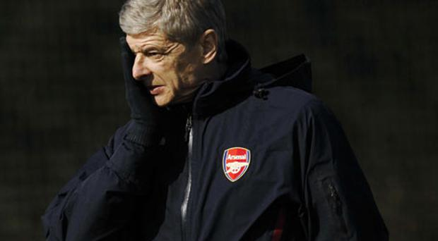 Arsene Wenger was in defiant mood yesterday as the fall-out continued from his argument with referee Massimo Busacca in Barcelona on Tuesday night. Photo: AP