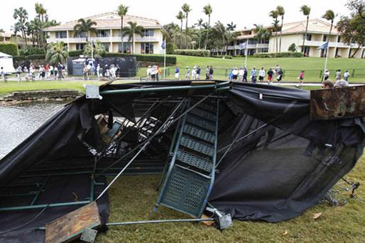 The wreckage of a television tower that was blown down by a heavy storm during the first round play of the WGC-Cadillac Championship at the TPC Blue Monster in Florida yesterday. Photo: Reuters