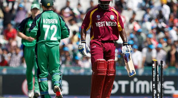 Devon Smith of West Indies departs after being bowled by Kevin O'Brien of Ireland for 107. Photo: Getty Images