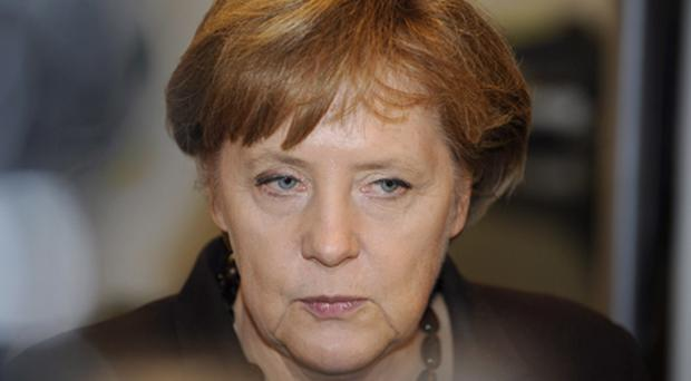 German Chancellor Angela Merkel said she would back lower interest rates on the emergency loans to Greece and Ireland in exchange for privatisations and a common corporate tax base in the euro region. Photo: Getty Images