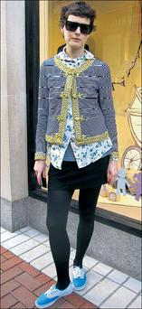 Jennifer Walsh. Jennifer twists tradition with a hooded floral print shirt and nautical-inspired jacket with gold brocade, topped off with killer shades and chilled out plimsoles.
