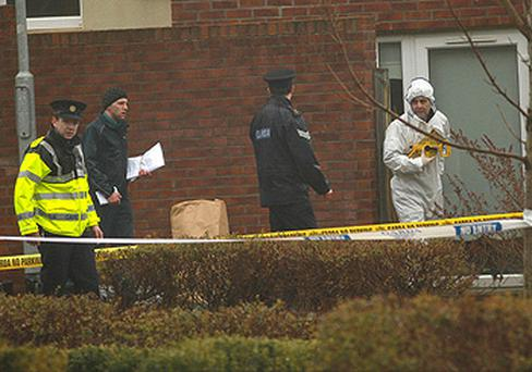 Gardai at the scene in Aiken Village, Stepaside, south Dublin where 17-year-old boy and 38-year-old man have been injured in a shooting. Photo: PA