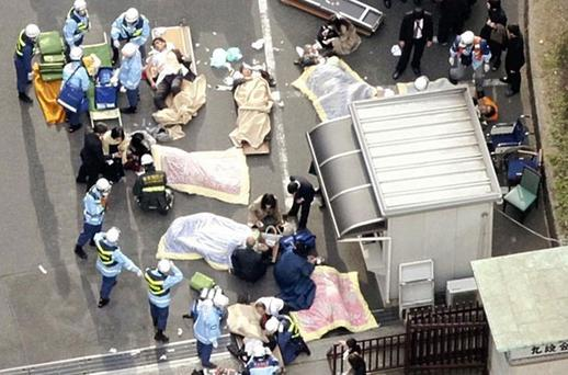 Rescue workers attend to injured people in Tokyo. Photo: Reuters