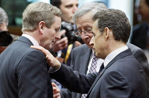 Ireland' s counterpart Kenny talks with his Luxembourg' s counterpart Juncker and France' s President Sarkozy during an EU extraordinary leaders summit on Libya and North Africa in Brussels. Photo: Reuters