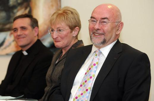 Education Minister Ruairi Quinn with Eileen Flynn, chairperson of the Catholic Primary School Managers Association, and Rev Denis McNelis, assistant chairperson, at the annual conference of CPSMA in Dublin yesterday. Photo: DAMIEN EAGERS