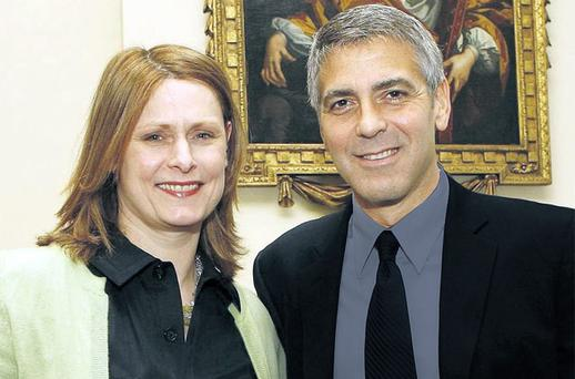 By George: Sarah with Hollywood actor George Clooney at Downing Street
