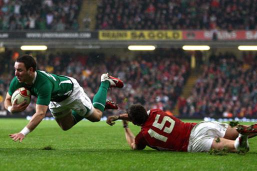 Lee Byrne tackles Ireland's Paddy Wallace near the try line in the dying minutes of Wales's victory at the Millennium Stadium on Saturday. Photo: PA