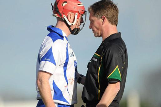 Referee Barry Kelly speaks with Waterford's John Mullane before showing him the yellow card during the Allianz Hurling League tie at Fraher Field in Dungarvan yesterday. Photo: Stephen McCarthy / Sportsfile