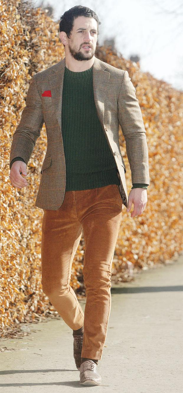Jacket, €354, Hackett, South Anne Street; green army jumper, Paul's own; rust cords, €60 both Topman. Shoes, Paul's own