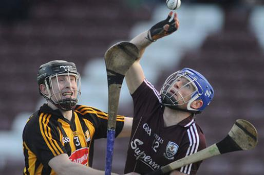 Kilkenny's John Dalton and Cyril Donnellan have eyes only for the ball as they battle it out as Pearse Stadium. Photo: Ray Ryan / Sportsfile