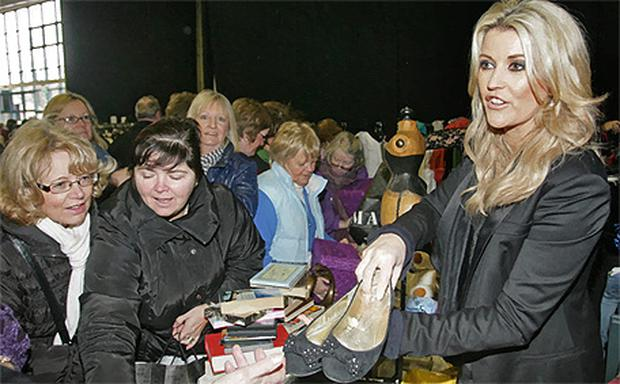Lisa Fitzpatrick offers some shoes for sale. Photo: GARETH CHANEY & ELEANOR KEEGAN