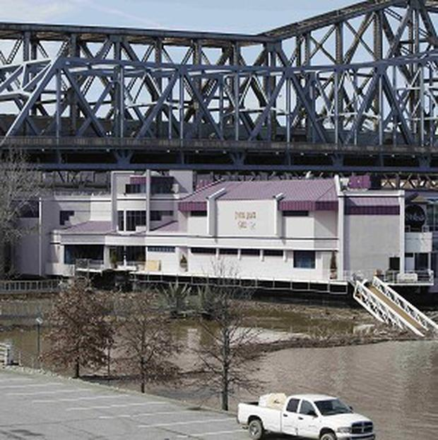 The Waterfront floating restaurant broke free from its dockside mooring on the rain-swollen Ohio River (AP Photo/The Cincinnati Enquirer, Tony Jones)