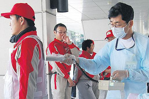 Technicians scan Red Cross rescue workers for signs of radiation in Nagahama City, Shiga Prefecture in northern Japan, yesterday