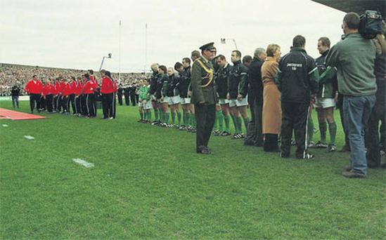 President Mary McAleese walks on the grass to meet the Irish team after England refused to adhere to protocol in their 2003 Six Nations meeting at Lansdowne Road. The decision by Martin Johnson gave England a lift and put them on the road to securing the Grand Slam crown.