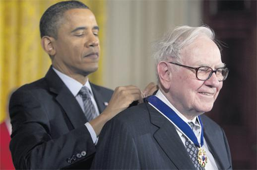President Barack Obama awards the Presidential Medal of Freedom to Warren Buffett, chairman and chief executive officer of Berkshire Hathaway, at a recent award ceremony in the White House for people who 'reveal the best of who we are and who we aspire to be'
