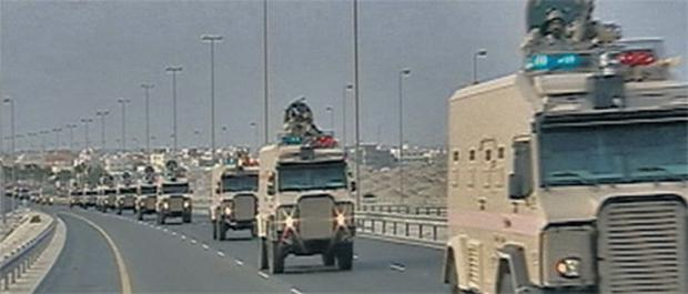 Saudi Arabian troops pour across the causeway to Bahrain after mainly Shi'ite protesters overran police and blocked roads (still image taken from TV news)