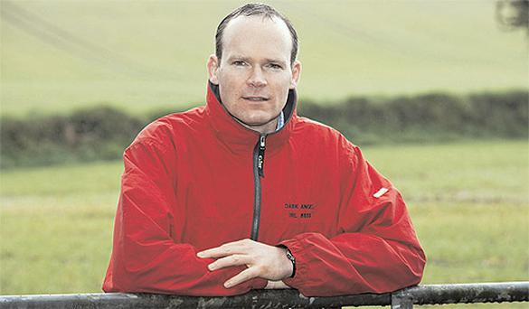 Simon Coveney , the new Minister for Agriculture, has a look around Robert's Cove, Co Cork, where his family farms.