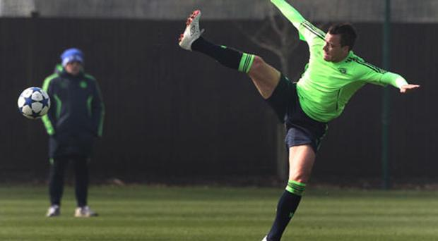 Chelsea captain John Terry trys to control ball during a training session at Cobham Training Ground. Photo: PA