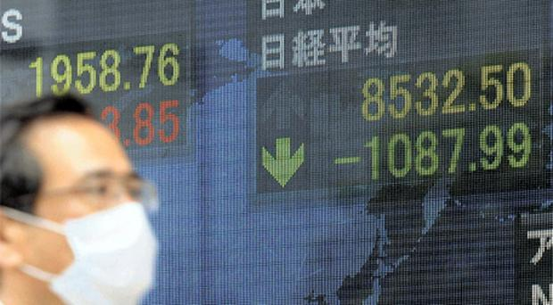 Japan's Nikkei share average plunged 10.6pc yesterday after a fall of 6.2pc on Monday, posting the worst two-day rout since 1987, as hedge funds bailed out after reports of rising radiation near Tokyo