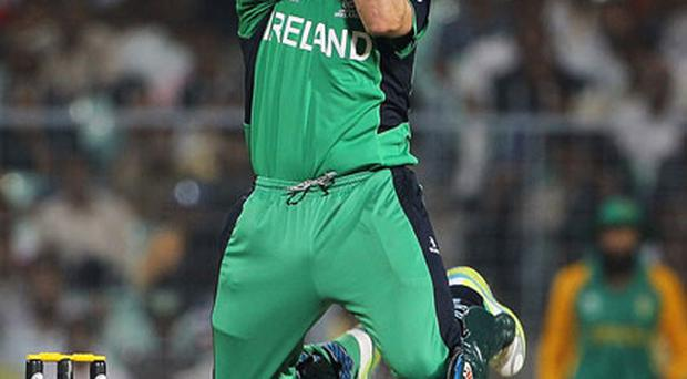 Ireland's Gary Wilson goes on the attack against South Africa during yesterday's ICC World Cup match in Kolkata, India. Photo: Getty Images
