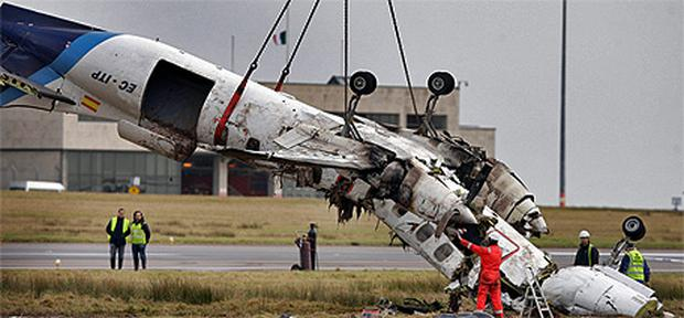 Wreckage of the plane is removed from the Cork airport runway following the February 10 crash. Photo: Steve Humphreys
