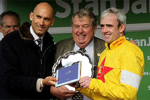 Jockey Ruby Walsh (right) and owner John Hales (centre) collect their trophies after Al Ferof wins the Stan James Supreme Novices' Hurdle. Photo: PA