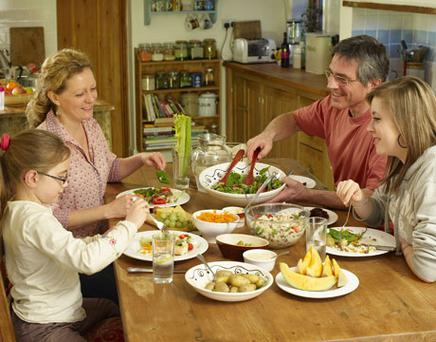 Sitting down and eating a family meal together at least three times a week builds strong bonds between parents and their children. Photo: Getty Images