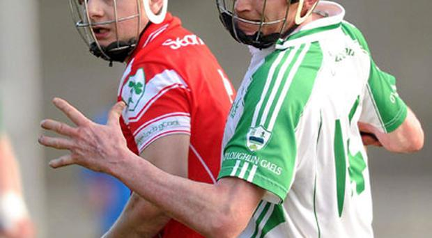 Martin Comerford, here in action against Mark McFadden of Loughgiel during their recent All-Ireland semi-final, has been crucial to O'Loughlin Gaels' march to today's Croke Park showdown with Clarinbridge.