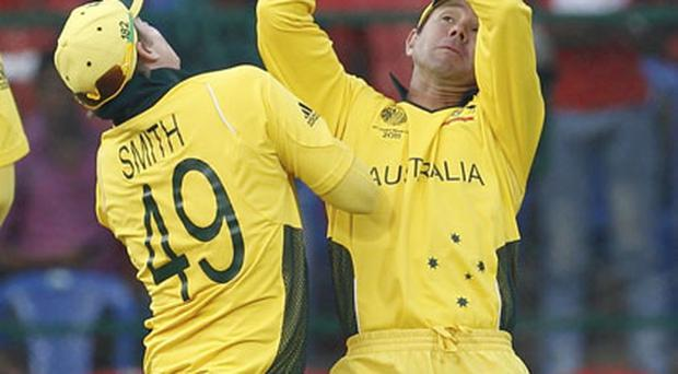 Australia's Ricky Ponting (R) collides with Steven Smith as he takes a catch to dismiss Canada's Harvir Baidwan during their World Cup game in Bangalore. Photo: Reuters