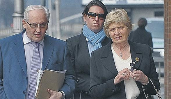 Philip Lynch with his wife Eileen and daughter Philippa arriving at court yesterday