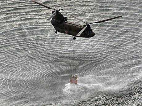 In their bid to avert a nuclear disaster, the authorities are using helicopters to scoop up seawater and douse the Fukushima nuclear plant. Photo: AP