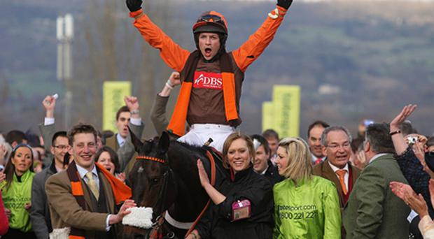 Jockey Sam Waley-Cohen celebrates winning the totesport Cheltenham Gold Cup on Long Run