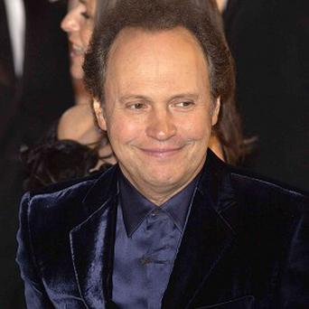 Billy Crystal said he would return to host the Oscars