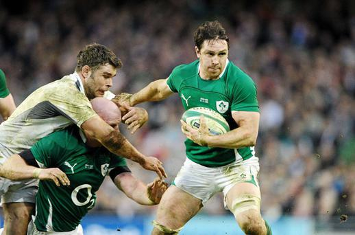 David Wallace, Ireland, evades the tackle of Nick Easter, England. Photo: Sportsfile