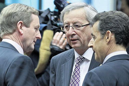 Enda Kenny talks with Nicolas Sarkozy and Eurogroup chairman Jean-Claude Juncker in Brussels this month