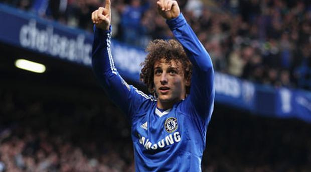 Chelsea's David Luiz celebrates after scoring his side's opening goal against Manchester City at Stamford Bridge yesterday. Photo: Getty Images