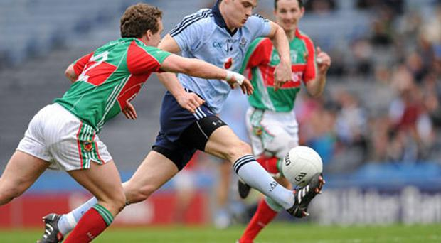 Dublin hat-trick hero Diarmuid Connolly tries to get away from Andy Moran at Croke Park yesterday. Photo: Ray McManus / Sportsfile
