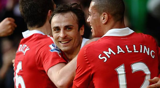 Manchester United striker Dimitar Berbatov celebrates his winning goal against Bolton Wanderers on Saturday. Photo: Getty Images