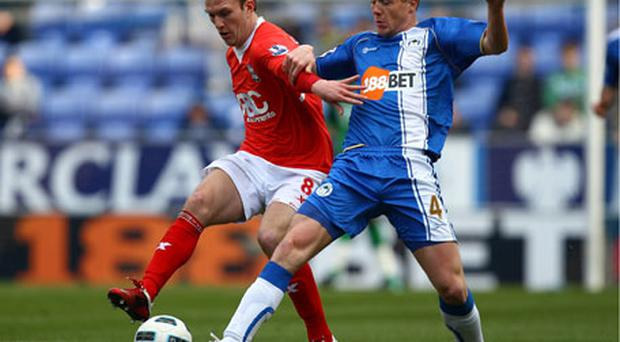 Wigan's James McCarthy battles for possession with Craig Gardener of Birmingham during their Premier League game on Saturday. Photo: Getty Images