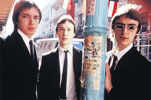 That's entertainment . . . Bruce Foxton, Rick Buckler and Paul Weller of The Jam pictured in 1977
