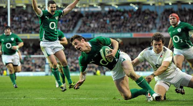 Tommy Bowe goes over to score his side's first try of the game despite the tackle of Tom Wood. Photo: Brendan Moran / Sportsfile