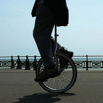 A unicyclist is fighting a three million dollar lawsuit after being fined for cycling on a pavement