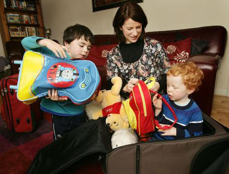 Flying can be trying: Hazel Gaynor pictured at home with children Max (five) and Sam (three).
