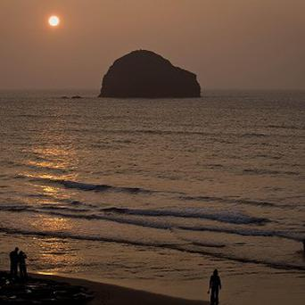The sunset looking towards Gull Rock off the north west coast of Cornwall, where people are being urged to state their nationality as Cornish in the census