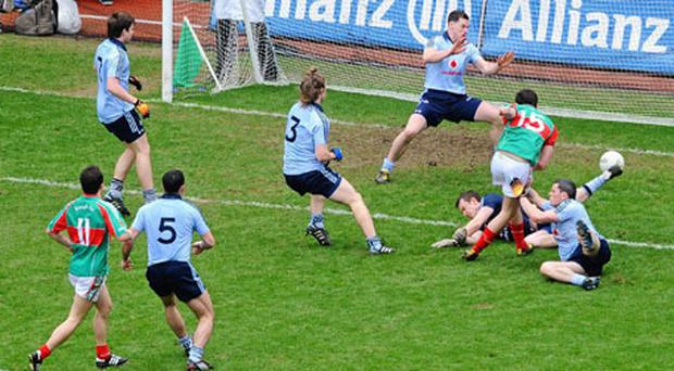 Jason Doherty of Mayo scores his side's second goal in Sunday's league clash when the Dublin defence leaked three goals.