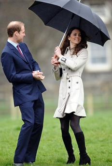 Britain's Prince William (L) accompanied by his fiancee Kate Middleton, watch a tug of war match during a visit to Greenmount Agricultural College near Belfast, Northern Ireland, on March 8, 2011. Prince William and his bride-to-be Kate Middleton arrived in Belfast on Tuesday for a one-day visit, under the watchful eye of armed police on the surrounding rooftops. AFP PHOTO/PAUL ELLIS (Photo credit should read PAUL ELLIS/AFP/Getty Images)