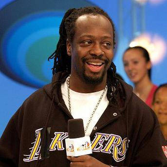 Hip-hop star Wyclef Jean has been released from a hospital in Haiti after being treated for a gunshot wound to his hand