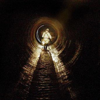 A 37-year-old US worker came loose from a safety line and slid about 3,000ft through a large sewer pipe