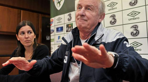 Interpreter Manuela Spinelli stands by as Giovanni Trapattoni makes a point at yesterday's press conference. Photo: David Maher / Sportsfile